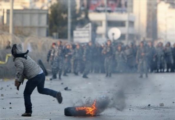 AP Photo/Hussein Malla _gli scontri di Beirut, ieri pomeriggio_